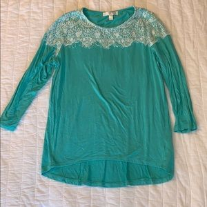Teal blouse with white lace